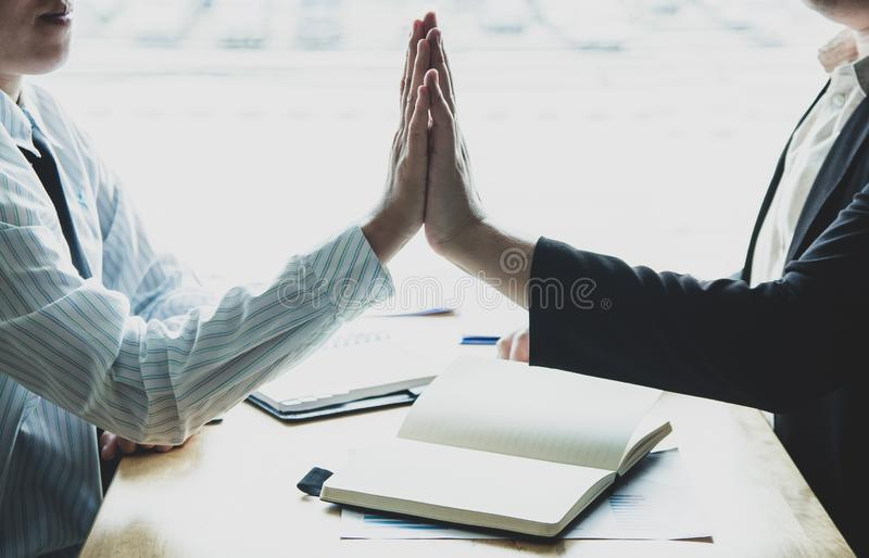 Two asian businessman together create a mutually beneficial business relationship. Teamwork royalty free stock photography