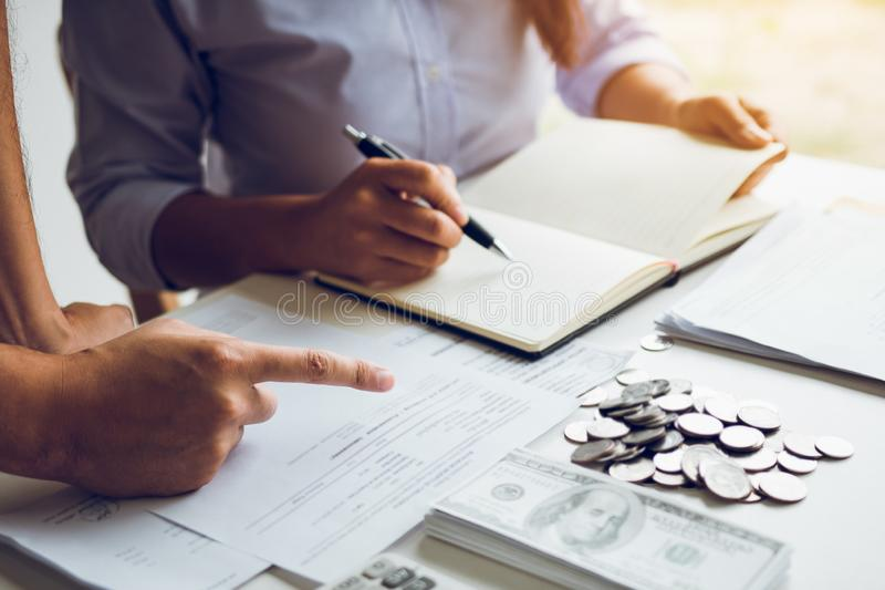 Two asian couples and men and women are together analyzing expenses or finances in deposit accounts and daily income sources with. An savings economical concept stock photography