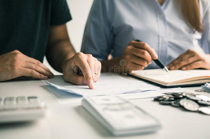 Two asian couples and men and women are together analyzing expenses or finances in deposit accounts and daily income sources with. An savings economical concept stock images