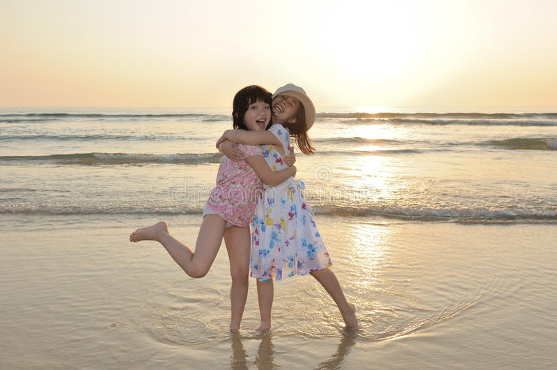 Two Asian kids playing on beach royalty free stock photos