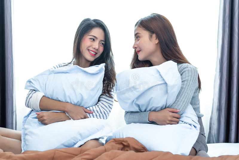 Two Asian Lesbian looking together in bedroom.Beauty concept. Ha royalty free stock photo