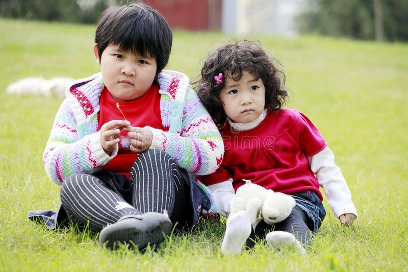 Download Two Asian Little Girls Outdoor Stock Photo - Image: 11254454