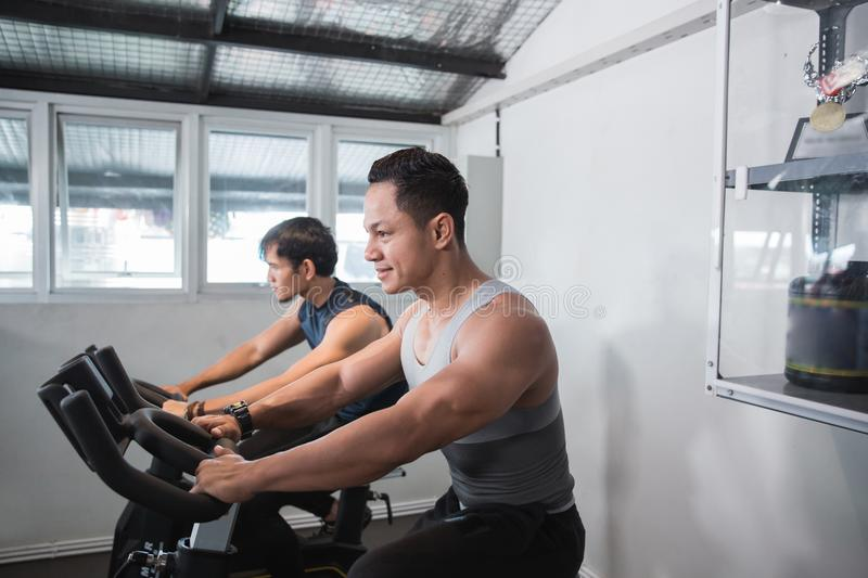 Two asian muscular male doing cardio excercises stock images