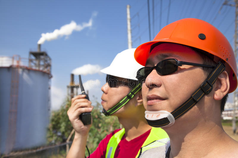 Two asian refinery workers royalty free stock photo