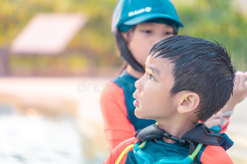 Two siblings in playing together in Water Aqua park pool royalty free stock images