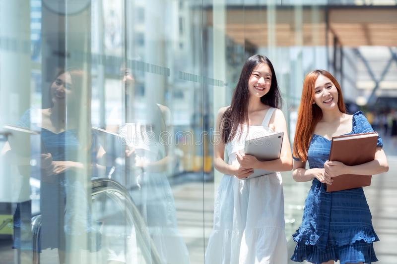 Two asian student walking to library in her univercity royalty free stock images