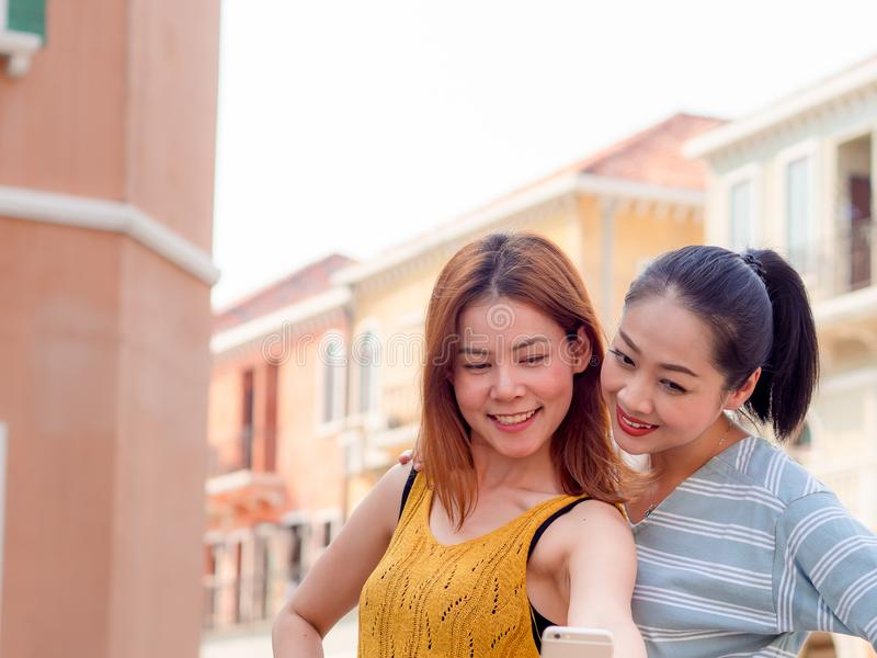 Two tourist women best friends are taking selfie of themselve. Two Asian tourist women best friends are taking selfie of themselve royalty free stock photo