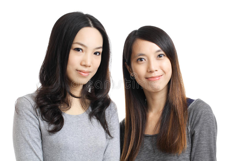 Two asian woman friend smile. Two asian women friend smile isolated on white background royalty free stock photo