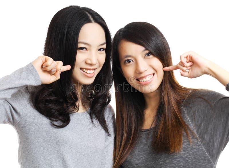 Two asian woman friend smile. Two asian women friend smile with white background stock photo