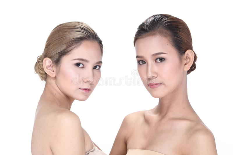 Two Asian women with beautiful fashion make up wrapped hair royalty free stock photography