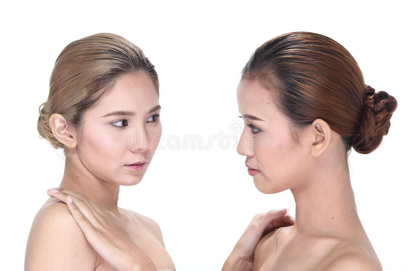 Two Asian women with beautiful fashion make up wrapped hair stock photo