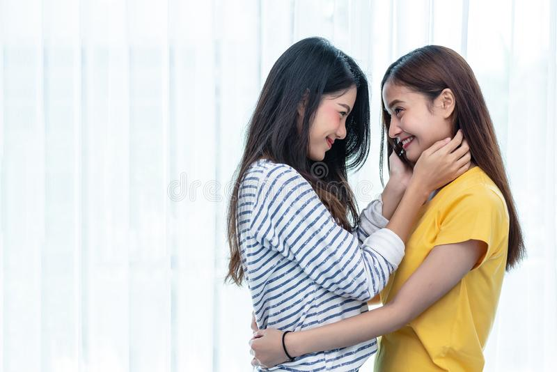 Two Asian women looking at each others in home. People and lifestyles concept. LGBT pride and lesbian theme. stock photos