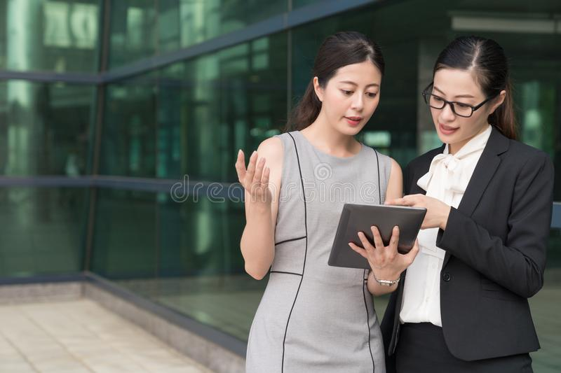 Two asian women office lady discussing business work together. W stock images