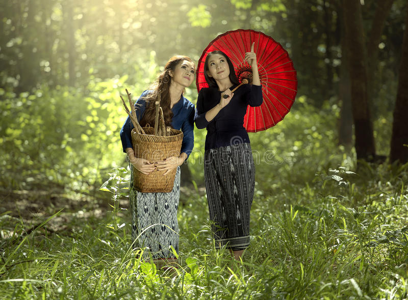 Two Asian women in traditional thai dress stock photos