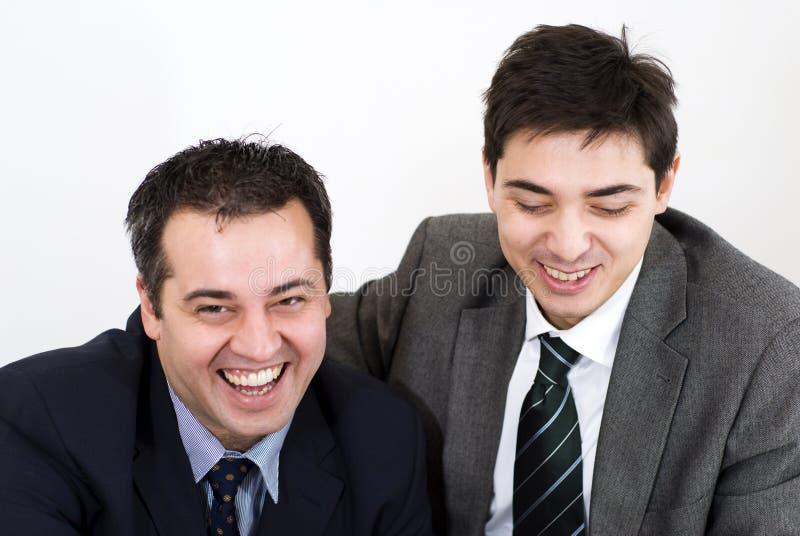 Two associates smiling stock photos