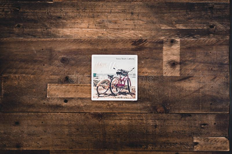Two Assorted Bicycles Illustration on Brown Wooden Surface stock photo