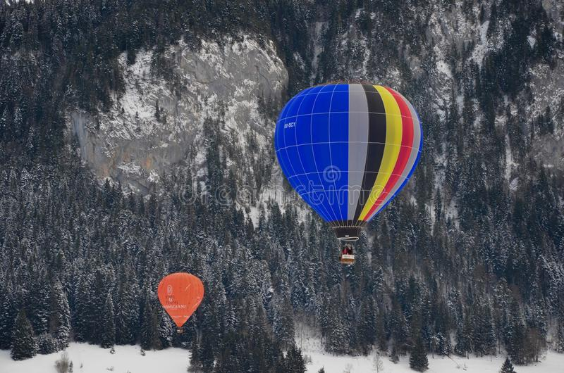 Two Assorted-color Hot Air Balloons over Green Trees stock photo
