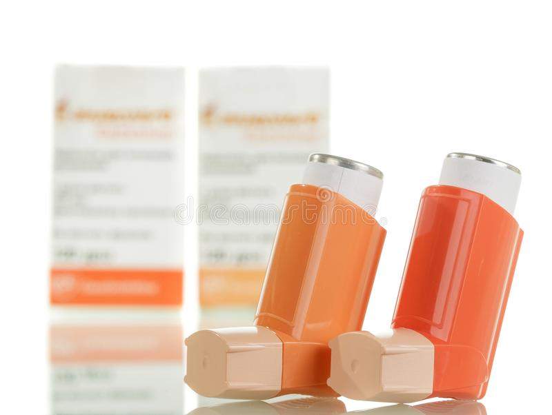 Two of the asthma inhaler and packaging of medicines on royalty free stock photos