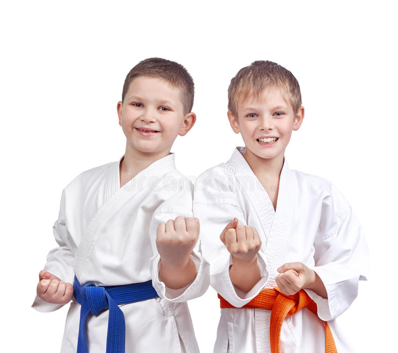 Two athletes doing karate technique. On the white background royalty free stock photos