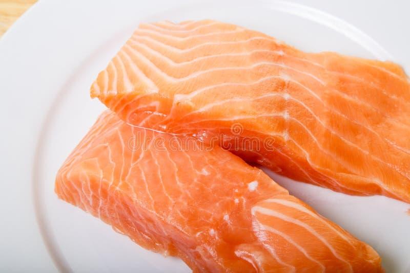 Two Atlantic Salmon Fillets Closeup. Two fresh, raw Atlantic salmon fillets stock image