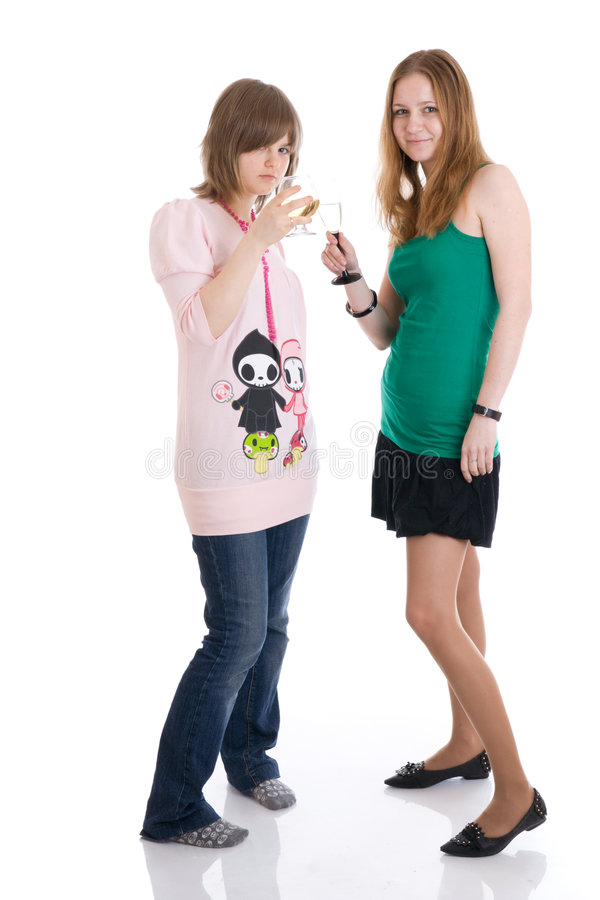Two Attractive Girls With Glasses Of Wine Isolated Stock Photo
