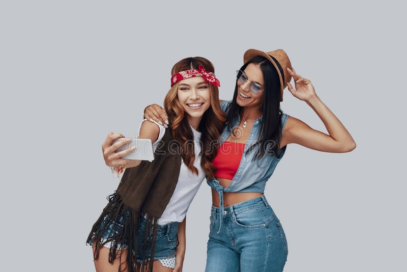 Two attractive stylish young women stock photography