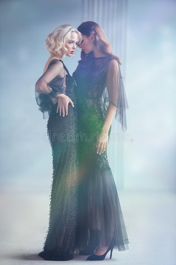 Two attractive women stock photos