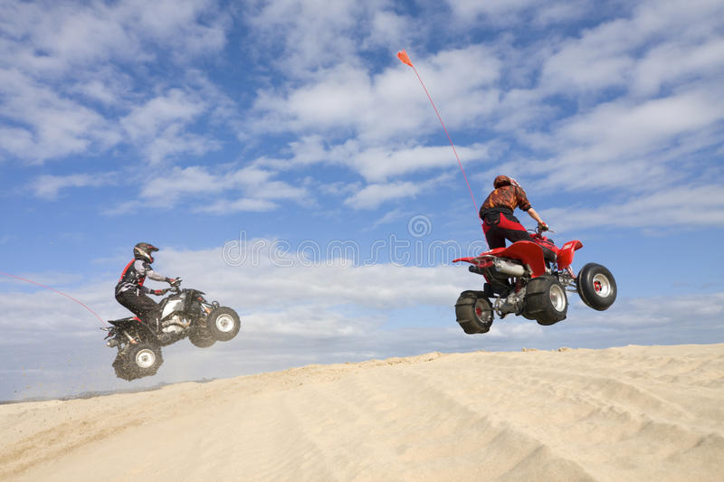 Download Two atv jumpers stock image. Image of helmet, cirrus - 13192247