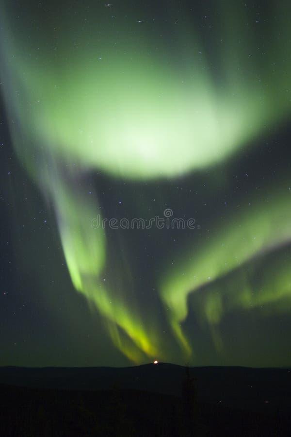 Two auroral arcs stock image