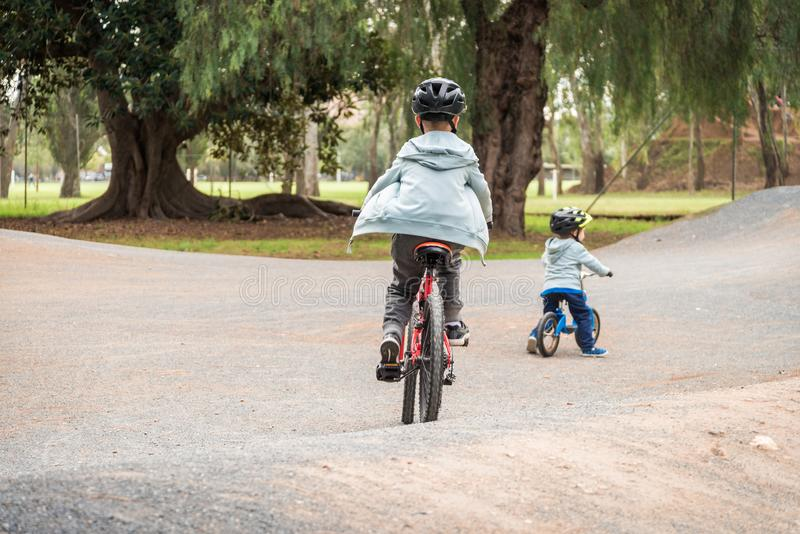Two australian boys riding bicycles on bike track in Adelaide royalty free stock images
