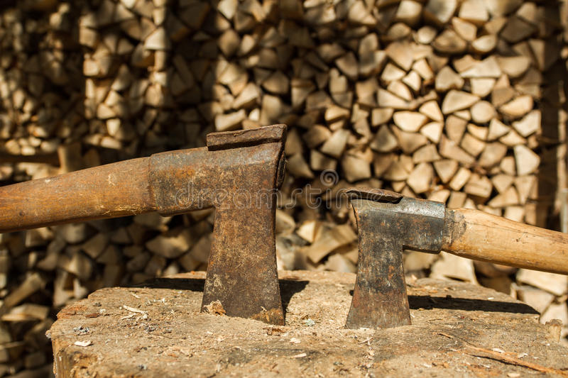 Two axes. Two old axes. It is shot it forest road stock photos