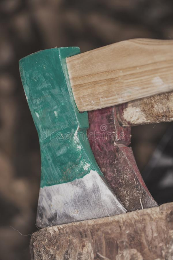 Two axes stuck in a stump. Close up royalty free stock photos