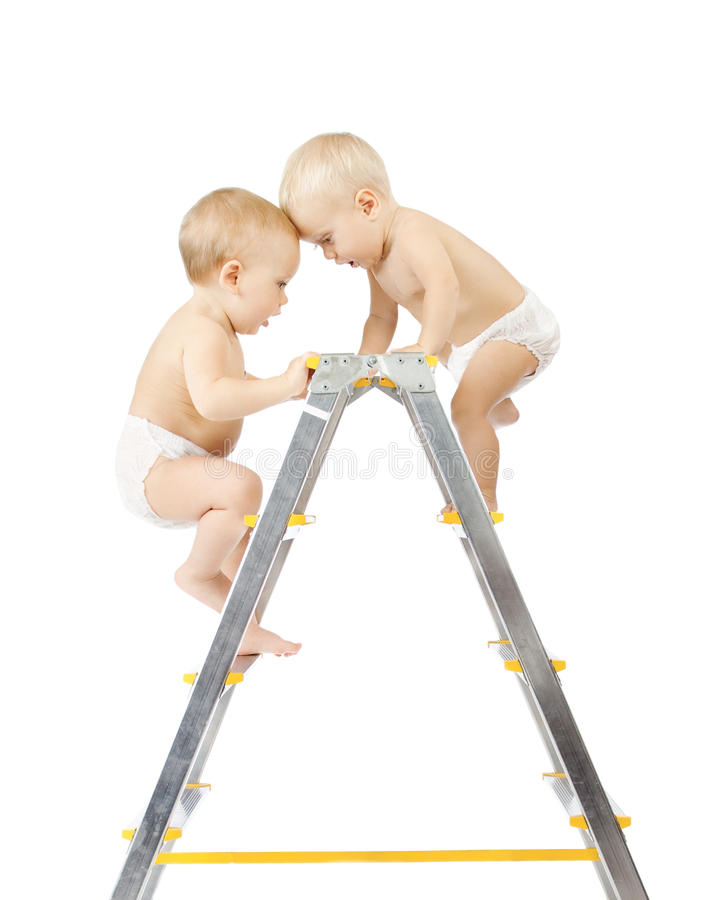 Download Two Babies Climbing And Fighting On Stepladder Stock Photo - Image: 25379094
