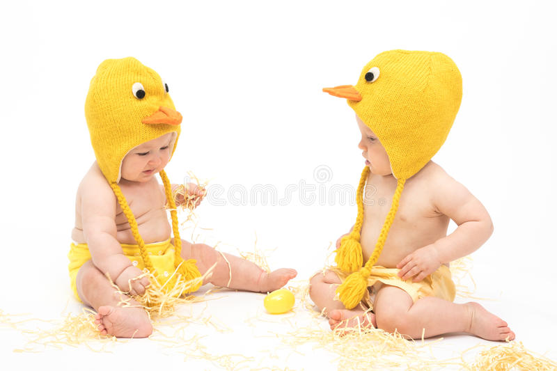 Two babies in Easter Chicken Costumes royalty free stock images
