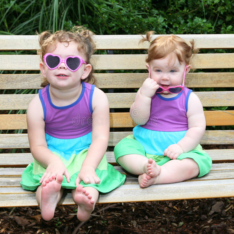 Download Two Baby Girls In Sunglasses And Sun Dresses Stock Image - Image: 14853365