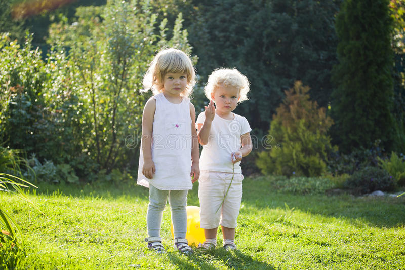 Two baby stand stock images