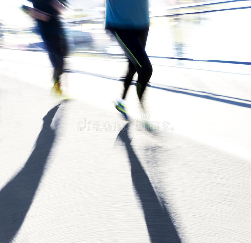 Two back lit joggers royalty free stock photos