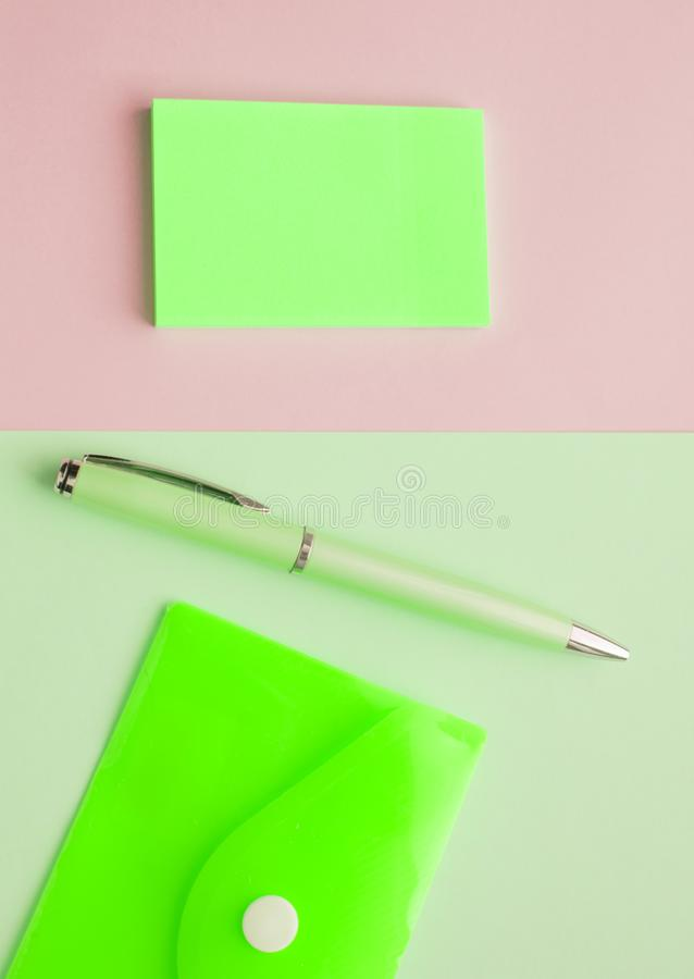 Two backgrounds side by side, vertical frame with mint green and pink pastel background, Flatley, note stickers, plastic envelope. And pen, lay, neon, tiffany royalty free stock image