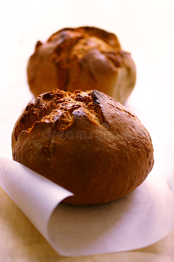 Two baked bread loaves stock images
