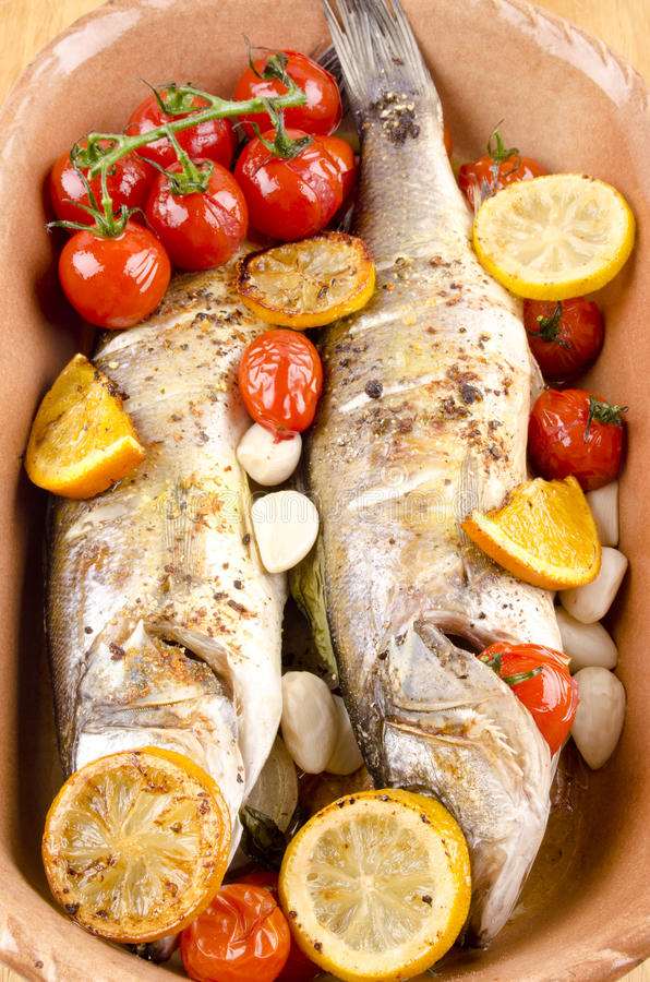 Two baked sea bass stock image
