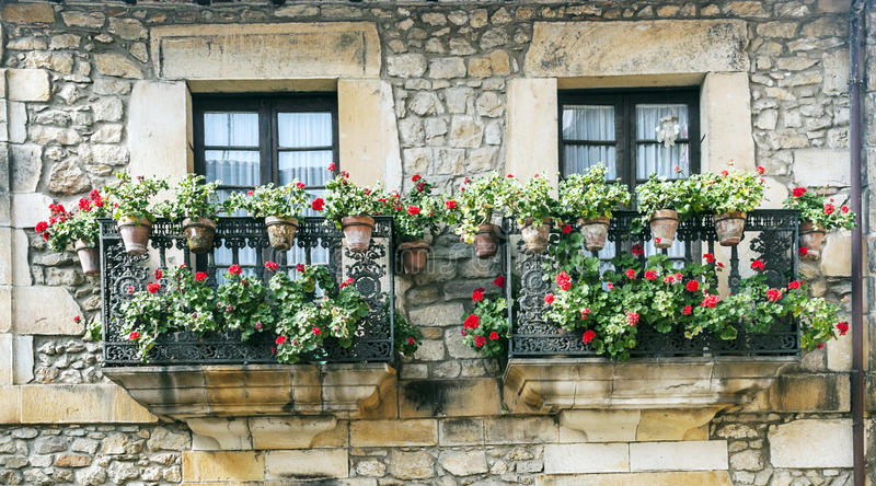 Two balconies with potted plants royalty free stock photography