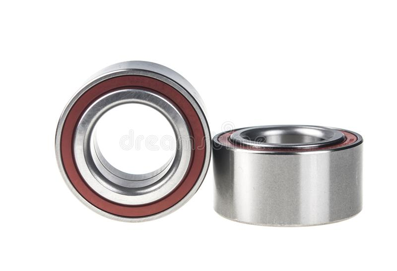 Two bearings on the white background. Two ball bearings, isolated on white background with clipping path stock images
