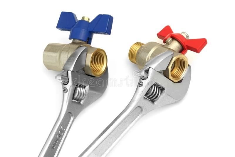 Two Ball Valves Grabbed With Adjustable Wrench On White. Two Ball Valves Grabbed With Two Adjustable Heavy Duty Wrench On White Background, Close Up, High Angle royalty free stock image