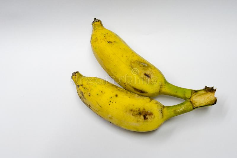Two bananas ripened on a white background. stock photo