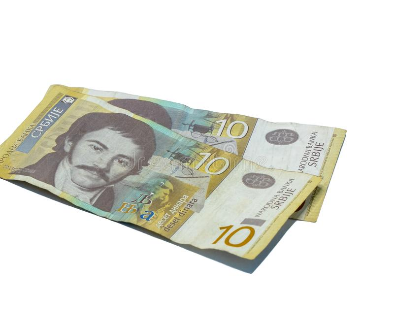 Two  banknotes worth 10 Serbian Dinars with a portrait of a Linguist Vuk Karadzic isolated on a white background. Two banknotes worth 10 Serbian Dinars with a royalty free stock photography