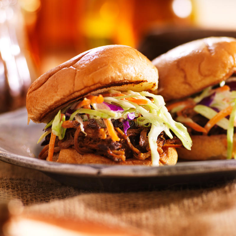 Two barbecue pulled pork slider sandwiches. Shot close up with selective focus stock photo