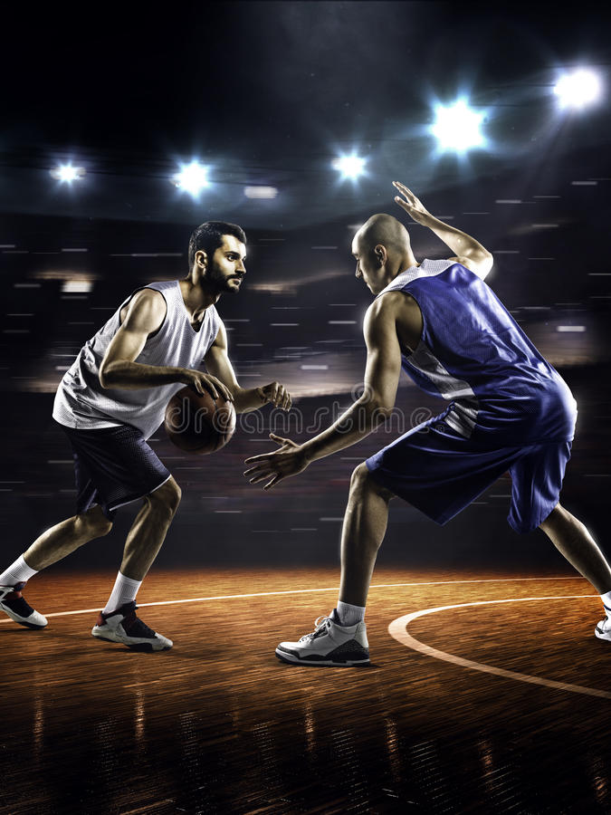 Two basketball players in action royalty free stock photos
