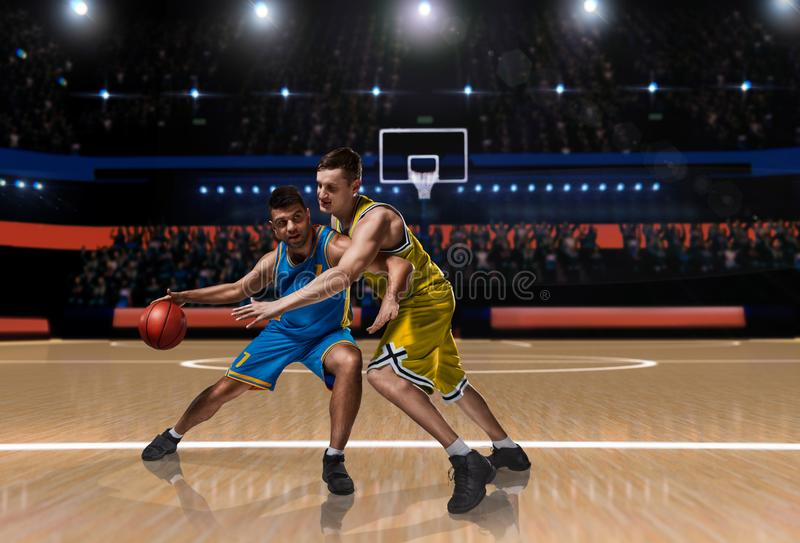 Two basketball players in scrimmage during basketball match stock images