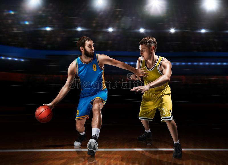 Two basketball players in scrimmage during basketball match royalty free stock photography