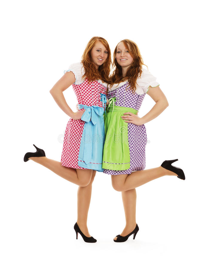 Download Two Bavarian Dressed Girls Lifting Their Feet Stock Photo - Image: 21812720